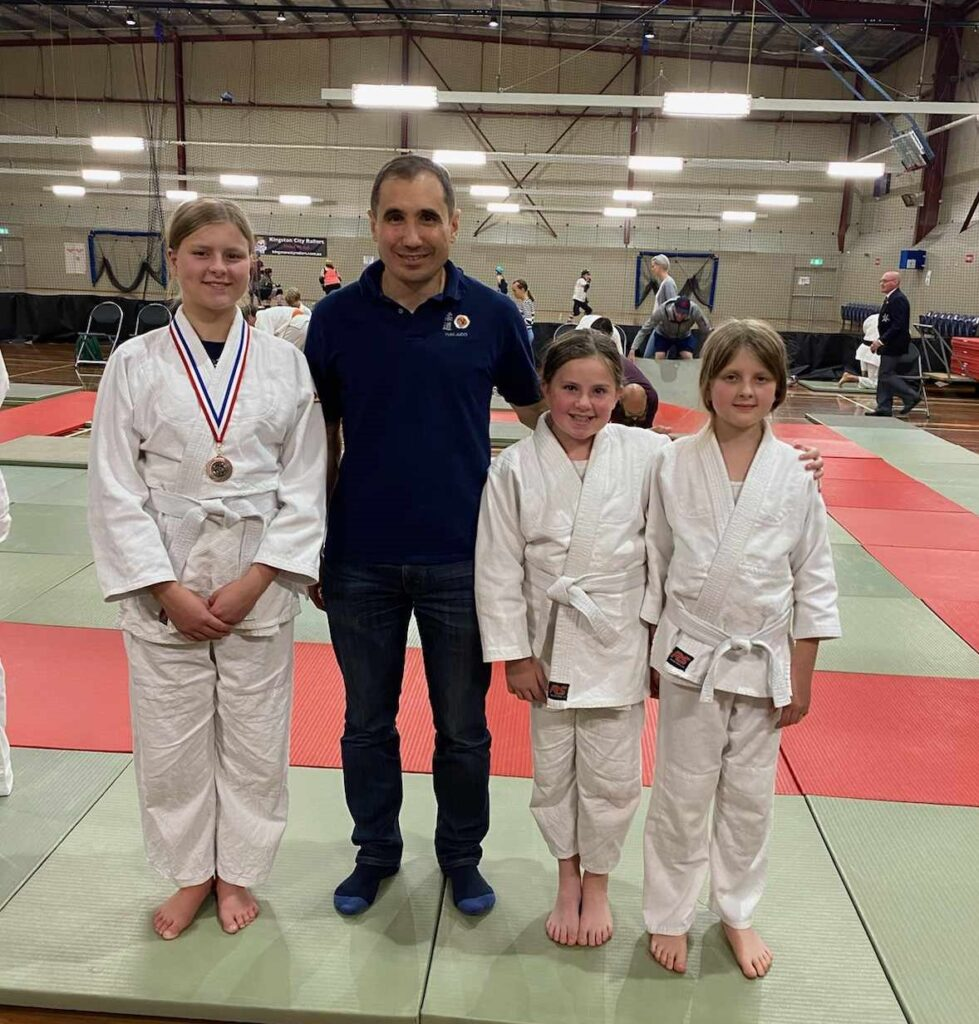 Photo of the three Yuki Judo participants with our coach Clau